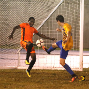 Wolues' Leo Forte, right, tries to score infant the goal as One Love's Antonio Russel prepares to block the shot