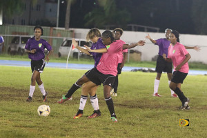 Avengers' Britney Peters, right and Ball Stars' Lilly Pierce battle for ball control