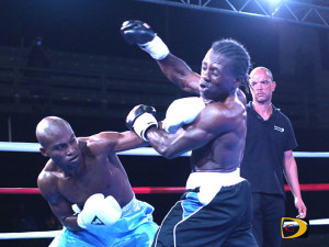 "Julan ""Iron Fist"" Brown plants a left hook on Jamaica's Miguel ""Iron Dog"" Ray, during their matchup in August"
