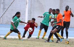 Virgin Gorda United goalie Diego Jimenez, prepares to block a shot during the first half of play against One Love