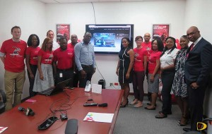 Digicel's General Manager Kevin Gordon, right and his staff following the launch of the LTE network
