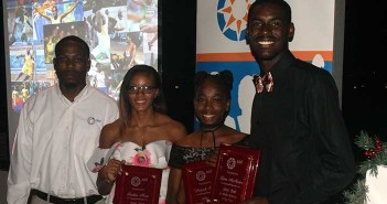 Sol representative Omar Jones, left, with Jr. Female, Athlete of the Year, Tarika Moses, Youth Female Athlete of the Year Ariyah Smith and Jr. Male Athlete of the Year, Kyron McMaster; PHOTO: Charlie Jackson