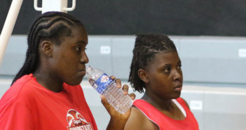 Shauliqua Fahie, left, and Mahkayla Pickering take a water break during the Digicel NBA Elite Camp at the Multipurpose Sports Complex in October