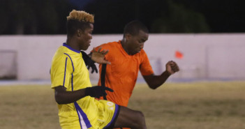 A Rebels player kicks the ball to his teammate before his One Love opponent could intercept the play