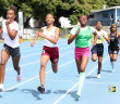 Athletes from Francis Lettsome, left, Althea Scatliffe and St. Georges, taking it out in the 600m during the Inter Primary A Division Championships on Thursday at the A. O. Shirley Grounds