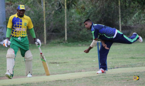 Cavaliers bowler Chrisnanand Dhangpaul makes a delivery late in the game as Vincy's tail ender Neil Niles, who resisted for a not out 45 looks on