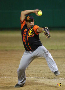 Yevris Rodriguez of Power Outage, winds up to make a delivery against a Pirates batsman, during the opening of the Virgin Islands Softball-Baseball Association Harriette Skelton Fast-pitch League opener at the E. Walwyn Brewley Softball Park on Sunday night