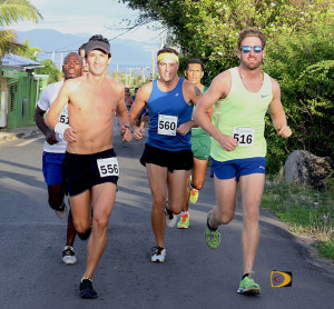 Guy Williamson, left, Julius Farley, behind Williamson, Jeremey Zuber, Reuben Stoby to Zuber's left and Vincent Fournier, forms the lead pack on Millionaire Road, in the early stages of Saturday's 6th Virgin Gorda Half Marathon.