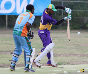 Royal Knights batsman Ryan Mangal, makes a defensive play in front of Wicket Keeper Jimmy Peters, that turned into a single when the Road Town Wholesale player misplayed the ball.