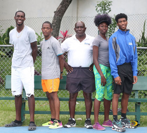 Coach Dag Samuels, center and his top Fast Lane Track Club athletes, Kyron McMaster, left, Shaquoy Stephens, Kala Penn and Ronique Todman, have all had a successful year, with each athlete recording personal bests this season. McMaster & Todman recorded 200m and 400m personal bests in Grenada over the weekend.