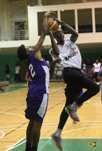 And One's Lestin Wiltshire, right goes prepares to shoot as the Stephano Paul of the Virgin Gorda Jr. Mystics tries to block