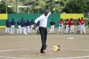 Hon. Myron Walwyn throws out the second pitch of the season