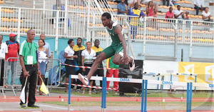 """Kyron McMaster clears the final barrier during last month's Carifta Games where he earned a bronze medal. PHOTO  by Dean """"The Sportsman"""" Greenaway"""