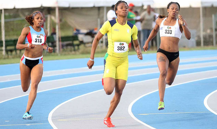 BVI's Ashley Kelly, right, St. Vincent & the Grenadines' Kenike Alexander and Antigua & Barbuda's Samantha Edwards competing in the 400m