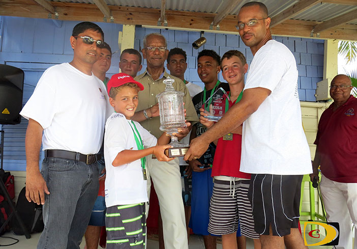 "Shan Mohamed, Daniel Petrovic, Jonathan Woods, Premier Dr. Orlando Smith, Jason Putley, Karie'jai ""KJ""Rhymer, James Dawson and Rotary Club of Tortola President Henry Creque, presenting the trophy to team Captain  Kyle Roose,"