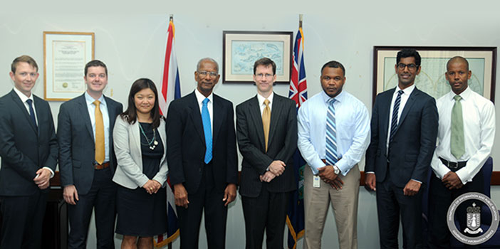 Premier and Minister of Finance, Dr. the Honourable D. Orlando Smith OBE is pictured here with senior Government officials and the Project Team of global management consultants, McKinsey & Co., following a contract signing undertake a Financial Services Management Consultancy which will help to chart a new direction in the financial services industry. The contract signing was held on August 12, 2014. (Photo Credit: Ronnielle Frazer/GIS)