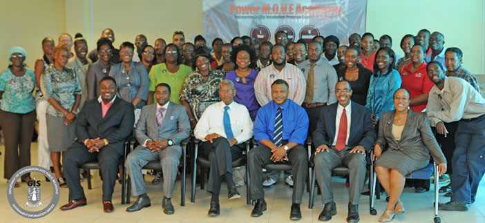 Premier and Minister of Finance, Dr. the Honourable D. Orlando Smith OBE is pictured here with graduates of the first session of the Power Move Academy Training Series, along with officials of the Power Move Academy and officials of the National Business Bureau at the awards ceremony on July 25, 2014. (Photo Credit: Ronnielle Frazer)