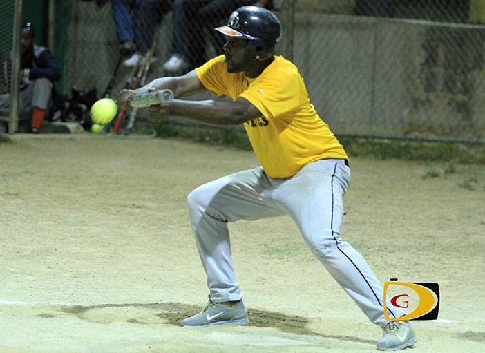 """Pirates' Dwight Brookes tries to get a bunt off Power Outage's pitcher Neville """"Sheep"""" Smith"""