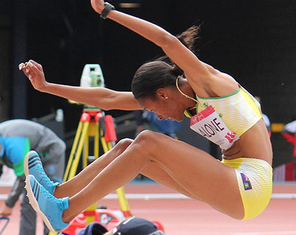 Chantel Malone sails through the air during the Long Jump finals at the XX Commonwealth Games in Glasgow, Scotland