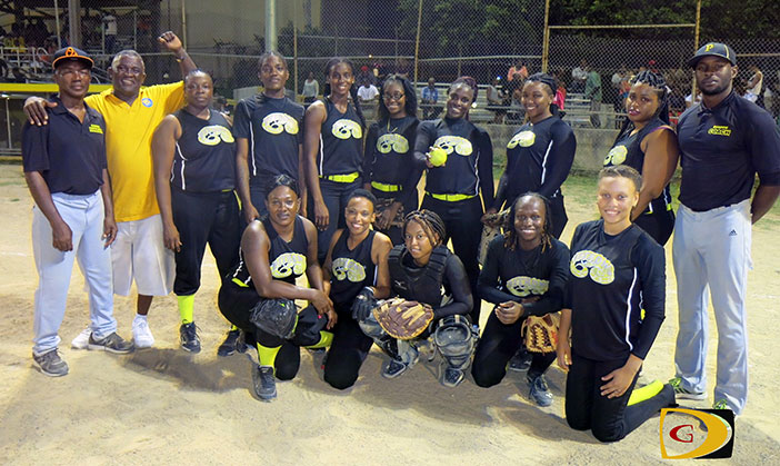 "Coach Terry ""Chino"" Chinnery, left, and his Pythons team celebrate their third straight BVI Softball Association league title"
