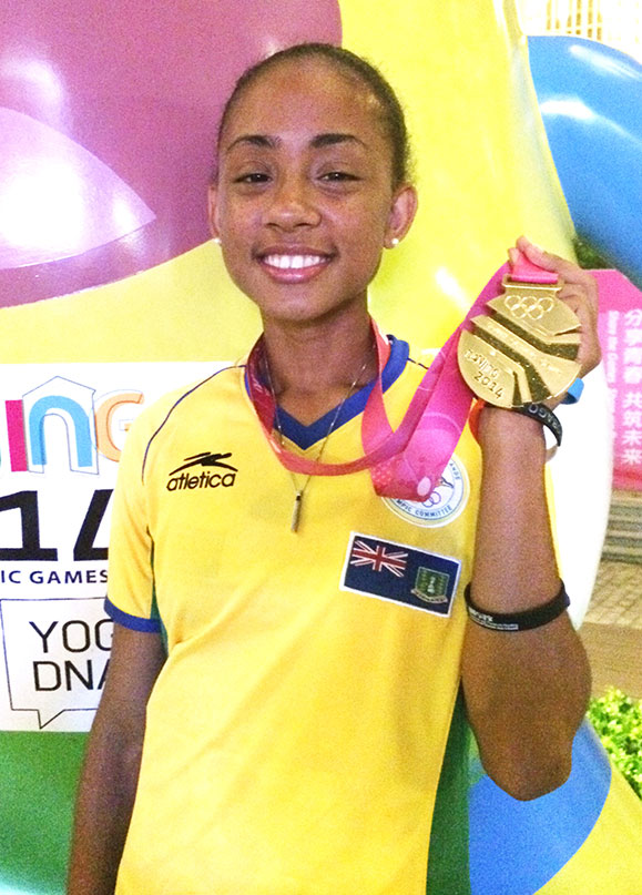 "Lakeisha ""Mimi"" Warner displays her Youth Olympic Games Mixed Relay gold medal"