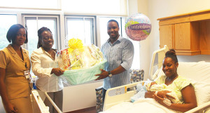 Dr. June Samuel and Heather Barnett presents the family with a gift basket.