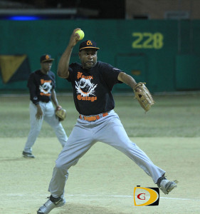 """BVI Softball Association President Neville """"Sheep"""" Smith, pitching during the finals of the 2014 League Championships Game 7"""