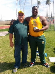 Eldred Henry, right, with his Central Arizona College coach Tony Dougherty after the first 20.00m throw of his career, a mark that ranked him No. 1 at all levels of the Collegiate world over the weekend.