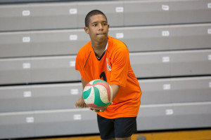 YEP Volleyball player Adrian Baijhnauth serving during a November 2014 tournament. PHOTO: Stacy Mather