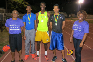 "Premier Dental chief executive Dr. Garfield Neita, left, with Ronique Todman, Kyron McMaster, Tarique ""Tweety"" Moses--the first three athletes to run the 400m under 50 seconds on home soil--and Melissa Flaherty"