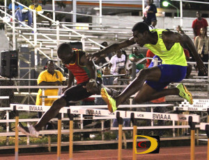 Oneil Thomas, left and the BVI's Kyron McMaster clears the last barrier in their epic 400m Intermediate Hurdles race
