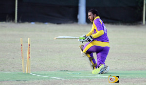 A Royal Knights player stares at the stumps in disbelief after being bowled out by the Cavaliers