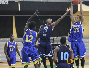 Elmore Stoutt High School Rams and Charlotte Amalie High School Chicken Hawks players battle for a rebound on Sunday