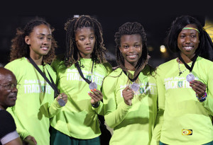 "The BVI's 4x4 team of Lakeisha ""Mimi"" Warner, Tarika ""Tinker Bell"" Moses, Taylor Hill and Jonel Lacey, showing their silver medal. PHOTO: Dean ""The Sportsman"" Greenaway"