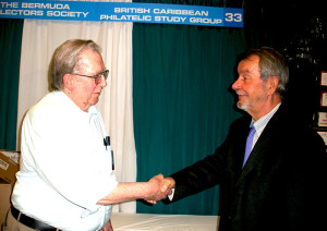 DENVER, Colorado: British Caribbean Philatelic Study Group president, Mr. Duane Larson congratulates BVI Philatelic Society president, Dr. Giorgio Migliavacca (at right) as recipient of the 2015 Addiss Award for lifetime achievement in philatelic writing and research.