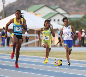 Taylor Hill, center, while competing at the Carifta Games. Hill moved to #6 on the BVI's All Time List with her 23.84 seconds 200m run and became the fastest U20 female.