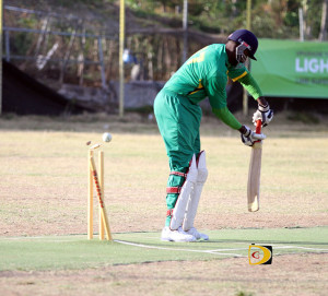 Ferris Pope is clean bowled by Grenada's Rodney Marryshow