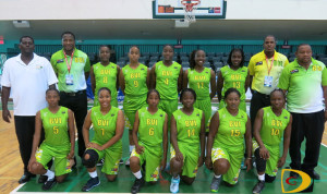Coaches, officials and players of the first Women's Basketball team to represent the territory in regional competition