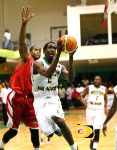Franklyn Penn goes to the hoop ahead of the Cayman Islands' Davion Cotterell for two of his six points. He had five against St. Vincent and the Grenadines