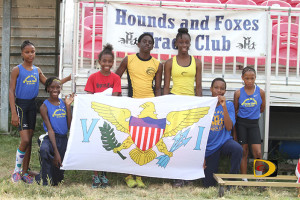 St. Croix's Hounds & Foxes Track Club members presents awards to the BVI top three division athletes in the CAC Age Group trials