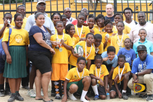Seventh Day Adventist Primary School's Tag Rugby team displays their wares after beating Cedar.