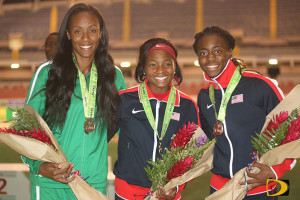 BVI's Chantel Malone, left, stands on the medal podium with the USA duo of  Quanesha Burns and Sha'Keela Saunders with their Long Jump awards