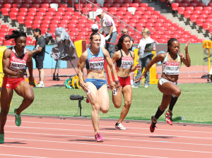 Taheisa Harrigan-Scott, far tight, competing in the Women's 100m Heat 5 in Beijing, China, against the Guam's Regine Tugade, Ukraine's Olesya Povkh and Trinidad and Tobago's Semoy Hackett.