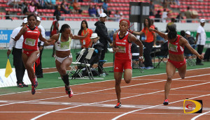 Tahesia Harrigan-Scott, 2nd left, is edged by Trinidad & Tobago's Michelle-Lee Ayhe by .06 seconds for the 100m bronze medal