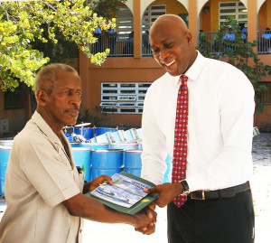 Dr. Quincy Lettsome  receives certificate from Minister for Education & Culture Hon. Myron Walwyn