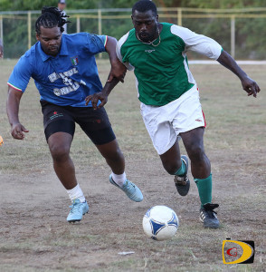 Combine Stars' Donovan Staples and St. Maarten Veterans' Fabrice Baly, battle for a ball on Saturday, during the Old Madrid Masters Football Tournament in Greenland