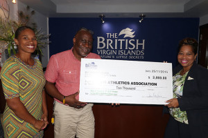 "Male and female participants in Saturday's race will be competing for the BVI Tourist Board top  prize of $1,000. Here, BVI Tourist Board Director Sharon Flax-Mars, right, and events coordinator Cindy Rosan-Jones, presents a check to BVI Athletics Association president Dean ""The Sportsman"" Greenaway."