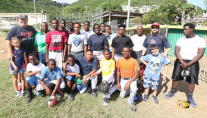 "Ernie Yarbrough, left, with young Softball and Baseball players along with Coach Terry ""Chino"" Chinnery and his son Shaun on Thursday at the Old Recreation Grounds"