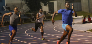 Ebenezer Joseph, right, leads Mikel Bassue off the turn in the 200m during Friday's BVI Athletics Association Development Series meet.