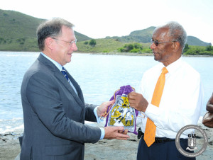 Salt Island descendant, Ms. Elcine Durante, presented a gift of salt to the Premier of the Virgin Islands, Dr. the Honourable D. Orlando Smith, OBE, who then presented the salt to His Excellency the Governor, Mr. John S. Duncan, OBE as a gift to Her Majesty Queen Elizabeth II in celebration of her 90th birthday [photo GIS]